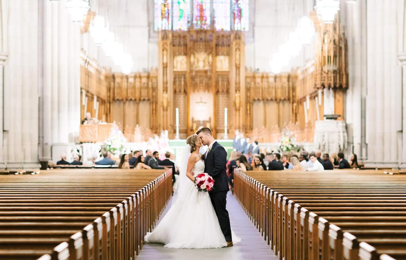 bride and groom kissing at Duke Chapel